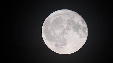 Full moon in the night sky after sunset during a september evening.