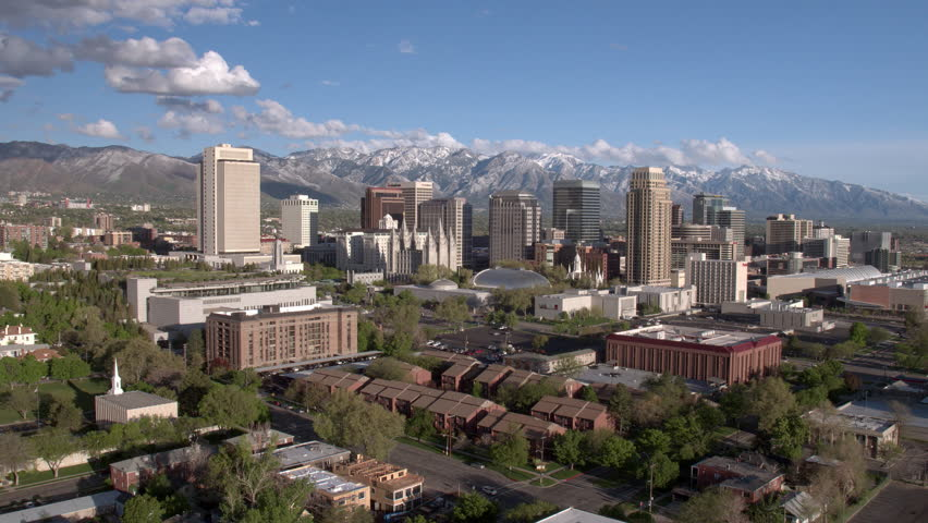 Salt Lake City, Utah skyline against the snow capped Wasatch Front mountains.
