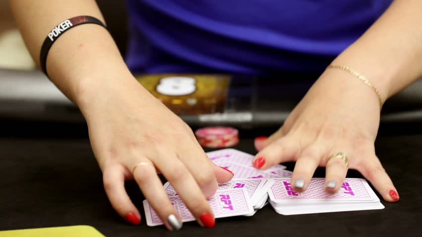 Close up of dealer and her hands during poker game . Group of professional poker players gather at players table gambling in poker tournament, championship . | Shutterstock HD Video #1017082123