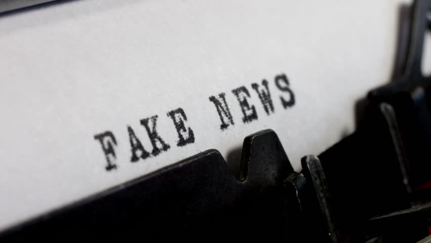 Disinformation and alternative facts. Fake News in black ink being typed on an old manual typewriter. | Shutterstock HD Video #1017083353