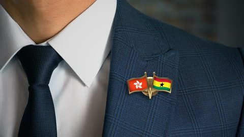 Businessman Walking Towards Camera With Friend Country Flags Pin Hong Kong - Ghana