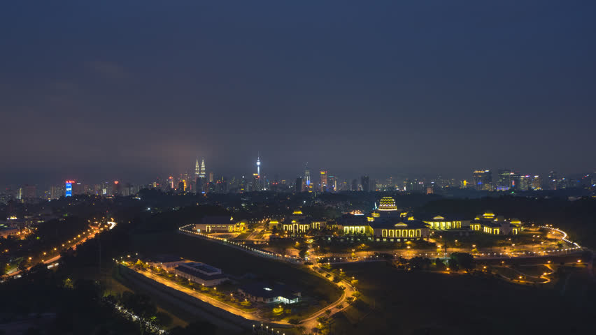 Time lapse: Dramatic night aerial view of the Kuala Lumpur skyline with the Malaysia national palace in the foreground and the national landmarks in the background. Prores 4K. | Shutterstock HD Video #1017108013
