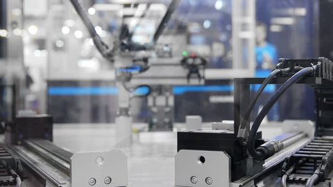 Automatic robot arm working in industrial environment closeup footage