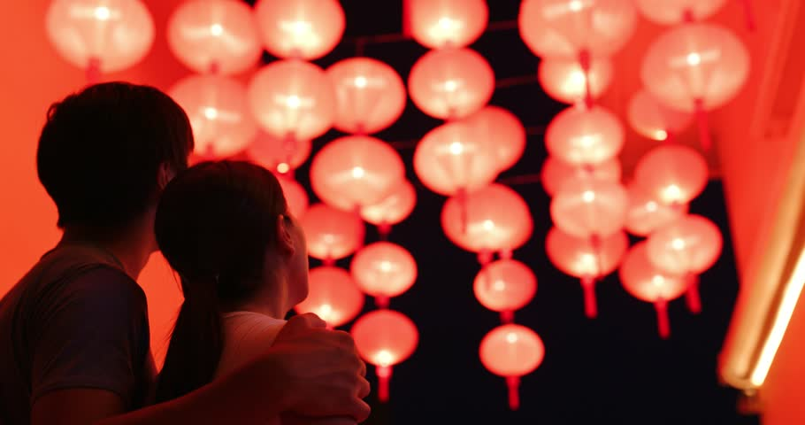 Couple enjoy looking at the red lantern at night | Shutterstock HD Video #1017154903