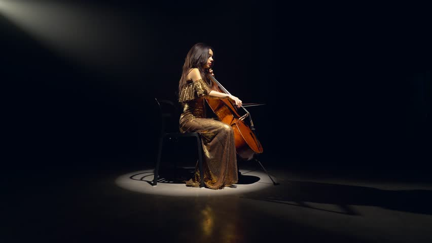 The cellist performs on stage. | Shutterstock HD Video #1017157063