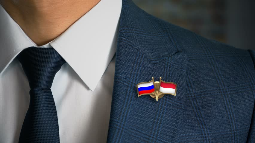 Businessman Walking Towards Camera With Friend Country Flags Pin Russia - Monaco