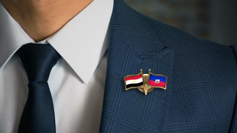 Businessman Walking Towards Camera With Friend Country Flags Pin Egypt - Haiti