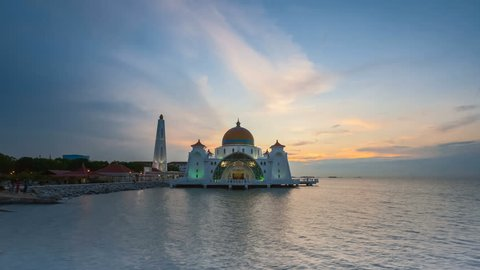 Dramatic Time lapse of sunset and scattered clouds at a floating Melaka Straits mosque in Malacca, Malaysia. Day to night. Prores 4K