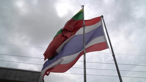 """Flag Thailand and Myanmar at Border checkpoint immigration Tachilek province, Myanmar Travel from """"Mae Sai"""" city of Thailand"""