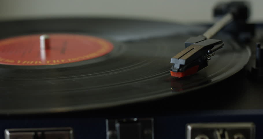 Vinyl Record playing on turntable - close up