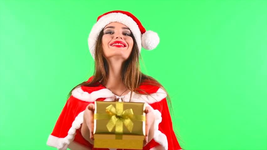 cda8b48504b1b Beauty Christmas surprised model girl giving Xmas gift box. Beautiful woman  in party costume