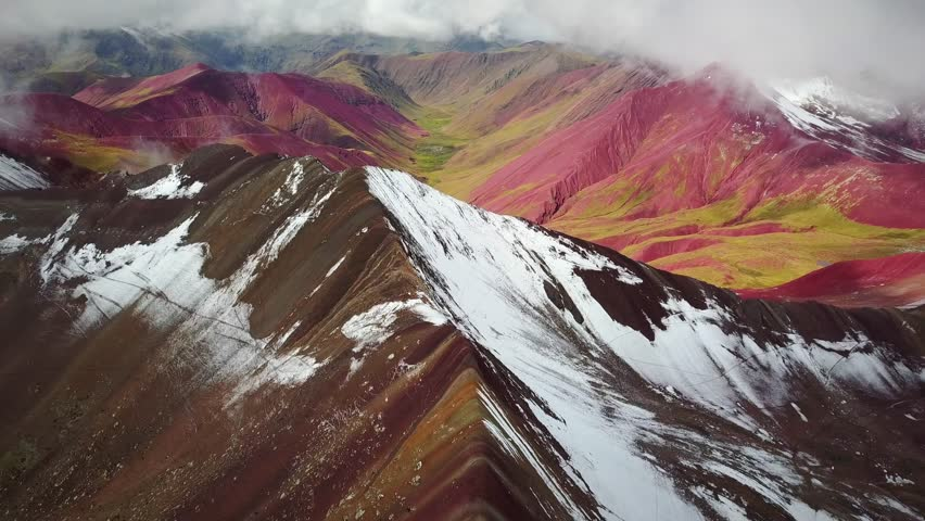 Aerial panoramic view of colourful Vinicunca, Rainbow Mountain, Peru. | Shutterstock HD Video #1017300643