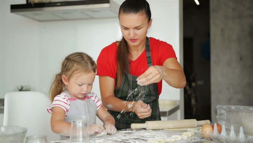 Happy Loving Family Are Preparing Bakery Together. Mother And Child Daughter Girl Are Cooking Cookies And Having Fun In The Kitchen. Homemade Food And Little Helper. | Shutterstock HD Video #1017330763