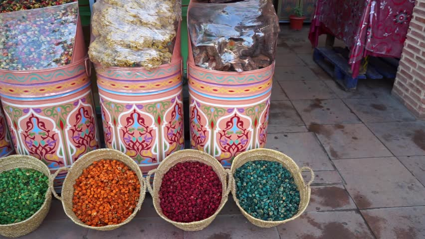 Spices and herbs on a moroccan souk market in the old town Medina in Marrakesh | Shutterstock HD Video #1017390583