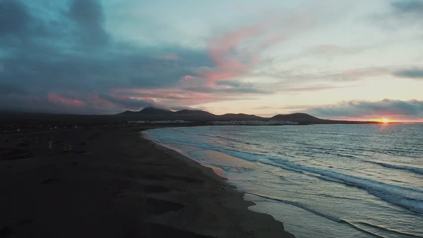 sunset on the beach aerial footage. Amazing colorful sky. Lanzarote, Spain