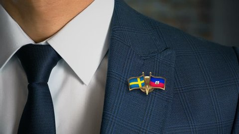 Businessman Walking Towards Camera With Friend Country Flags Pin Sweden - Haiti
