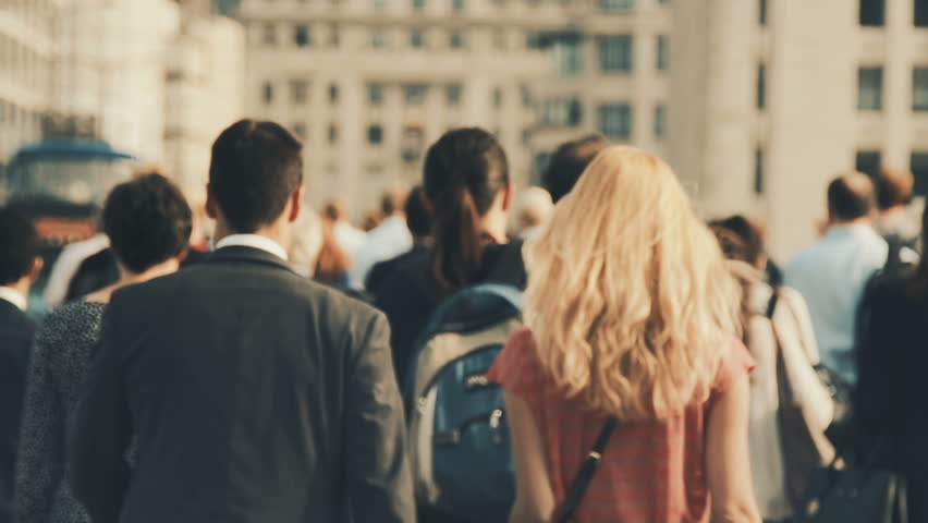 Anonymous crowd walking in a big city street. Commuters rushing to work.  Slow motion.  | Shutterstock HD Video #1017446563