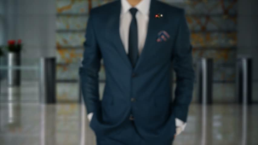 Businessman Walking Towards Camera With Friend Country Flags Pin Switzerland - Algeria   Shutterstock HD Video #1017451903