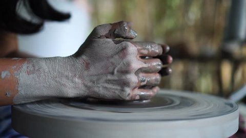 Potter's hands are creating earthenware on potter's wheel. Concept of natural materials, hand made and creativity : 4k