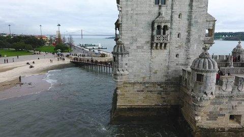 Drone cityscape reveal shot of Torre de Belem or Belem Tower in Lisbon, Portugal