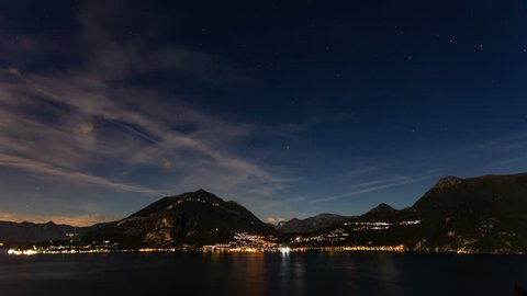 4k time lapse of clouds on a moonlit night over Lake Como, Italy