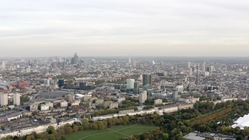 Aerial view cityscape of London with urban architectures. Icons of the London skyline feat residential neighborhood such as Euston, Fitzrovia, Marylebone with Central Famous Buildings in England, UK   Shutterstock HD Video #1017667843