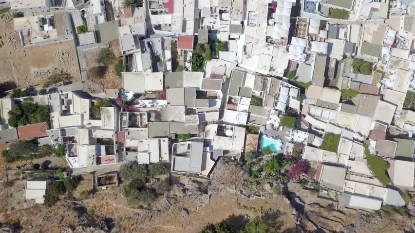 Aerial footage of typical traditional white houses of a Greek Island | Shutterstock HD Video #1017818293