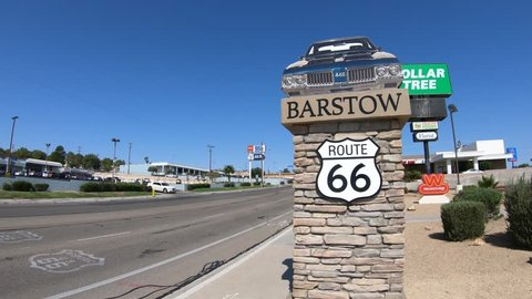 Barstow, California, USA - August 15, 2018: Barstow Sign with 1960s Oldsmobile 442 on main street Route 66. Barstow is in Mojave Desert between Los Angeles and Las Vegas.