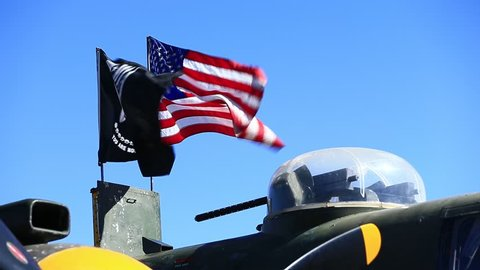 Minden, NV / USA - October 14 2018: American and POW-MIA Flags flying a-top a North American B-25 Mitchell at the 2018 Aviation Roundup Air show in Minden, Nevada