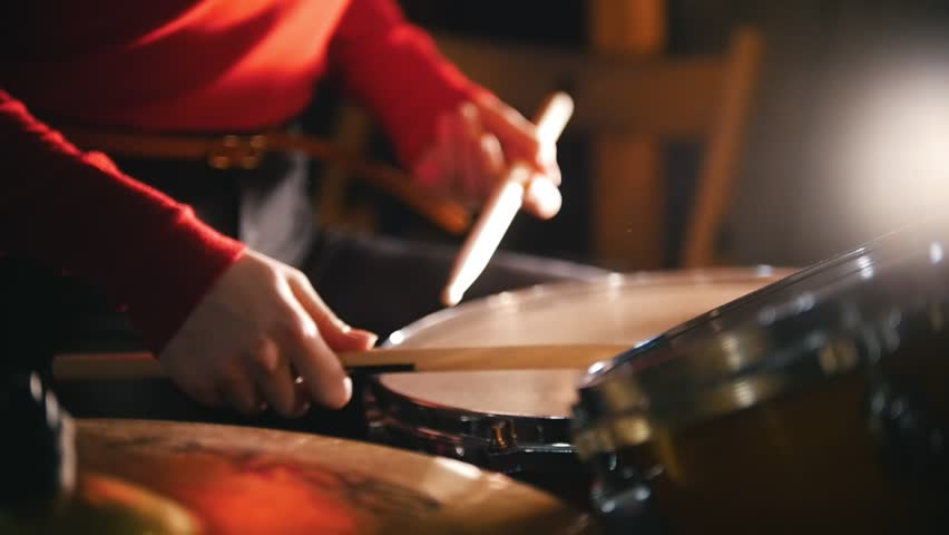 Repetition. Girl playing drums. Close up | Shutterstock HD Video #1017896713