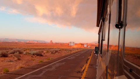Driving RV on highway at sunset on a out west vacation road trip
