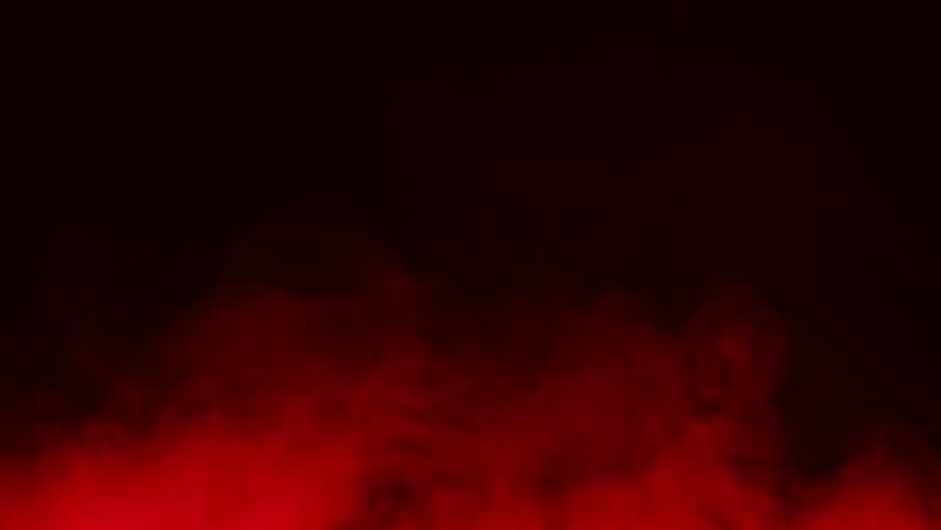 Colored cigarette smoke on a black background … - Royalty