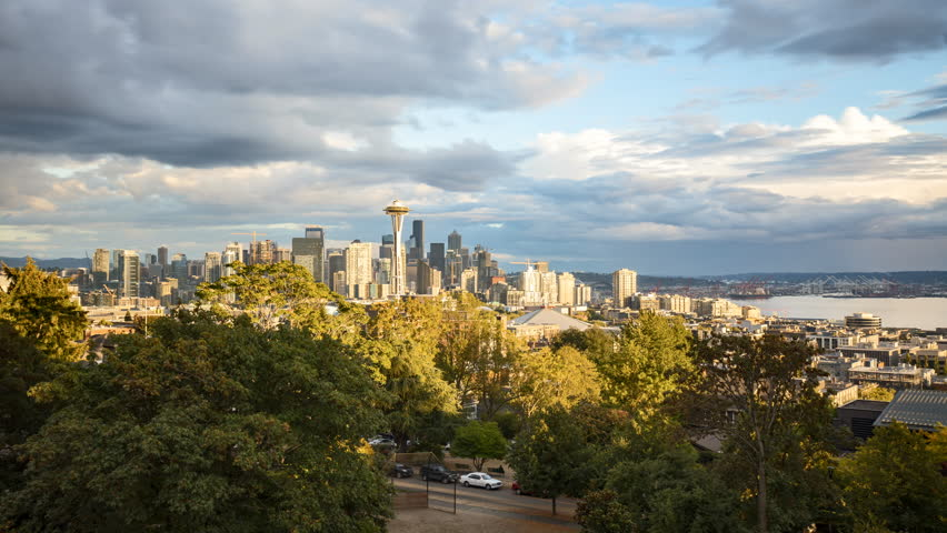 Time-lapse video of Seattle skyline from famous Kerry Park panorama viewpoint on a beautiful sunny day with blue sky and fast moving clouds in summer, Washington State, Pacific Northwest, USA