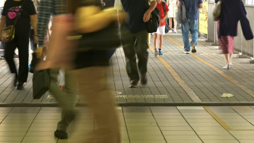 Timelapse of people moving along walk way in Hong Kong. | Shutterstock HD Video #1018164583