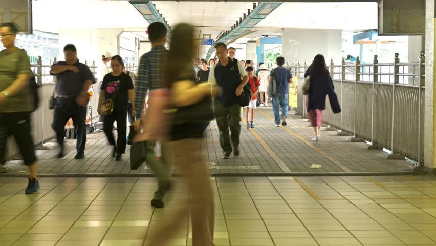 Timelapse of people moving along walk way in Hong Kong. | Shutterstock HD Video #1018164763