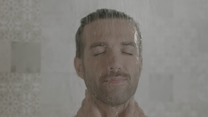 A handsome man in shower camera tilt down smiling and slow motion | Shutterstock HD Video #1018171723