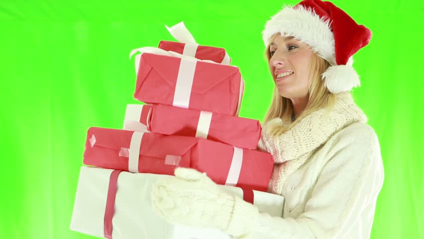 Cheerful young woman wearing Christmas hat and holding presents. Green screen   Shutterstock HD Video #1018174933