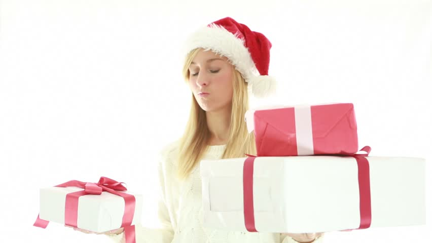 Christmas stress-Woman holding Christmas gift. White background  | Shutterstock HD Video #1018174963