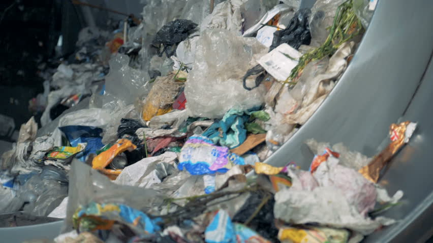 Lots of household trash is sorted for recycling at a plant. 4K.   Shutterstock HD Video #1018188403