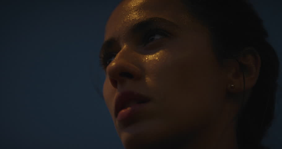 Young hispanic woman runner resting exhausted after intense running exercise in city at night training cardio workout enjoying urban fitness lifestyle close up sweating face | Shutterstock HD Video #1018212493