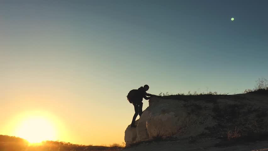 Young tourist climbs the mountain. Hands of the climber hanging on rock. Rock Climbing, Mountain Climbing, Hiking. | Shutterstock HD Video #1018229293