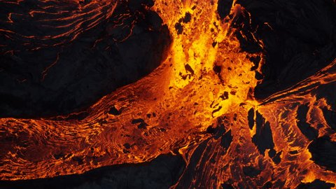 Aerial view of powerful active volcano a river of natural explosive erupting red hot active magma from within earths crust Kilauea Hawaii USA RED WEAPON
