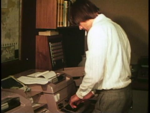 LONDON, ENGLAND, 1976, Currency trading room, Barclay's, teletype machine