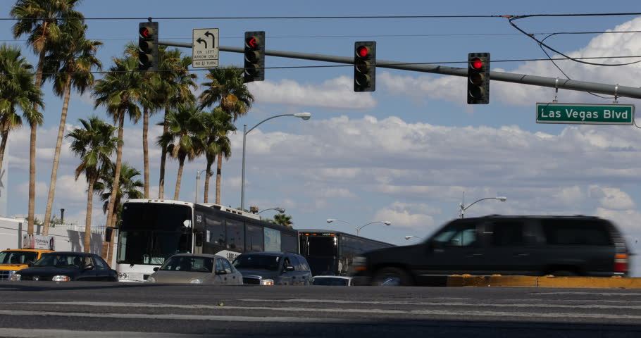 Red Light and Street Sign on Boulevard with Cars Traffic on Las Vegas Strip Day | Shutterstock HD Video #1018472173