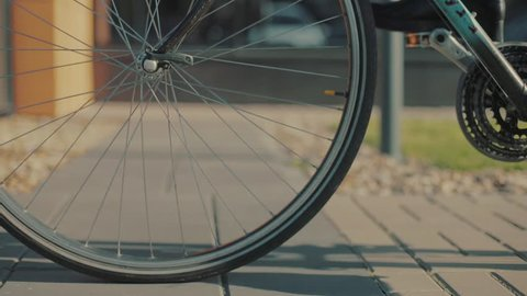 Close up cycling road bicycle outdoors fitness steadicam shot transportation speed fit person sun sport bike ride active action cyclist health lifestyle male man adult biker slow motion