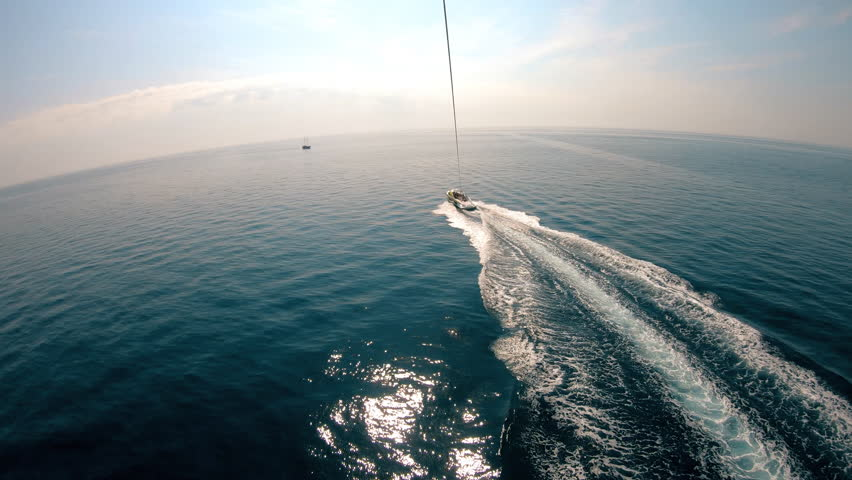Parasailing.Towing a parachute with passengers.The guy with the girl in free flight . Sharp sensation.  Water entertainment.Gopro. | Shutterstock HD Video #1018494433