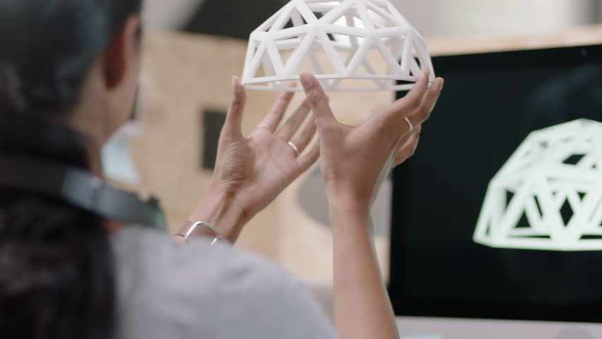 Creative business woman engineers design geodesic dome 3d printing model indian woman showing colleague ideas in modern startup office successful team sharing development project