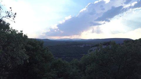 Gorge Ardeche aerial push forwards dusk reveal through trees