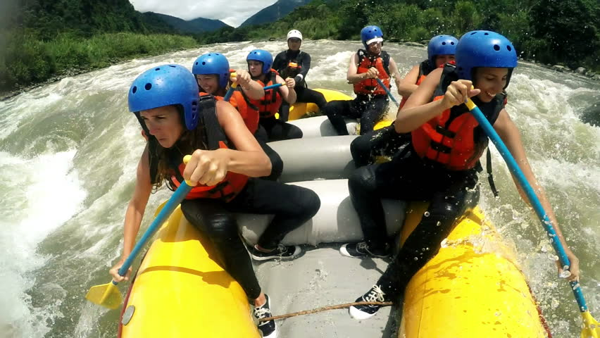 Group of adult women's screaming and yelling while whitewater rafting, model released clip with audio