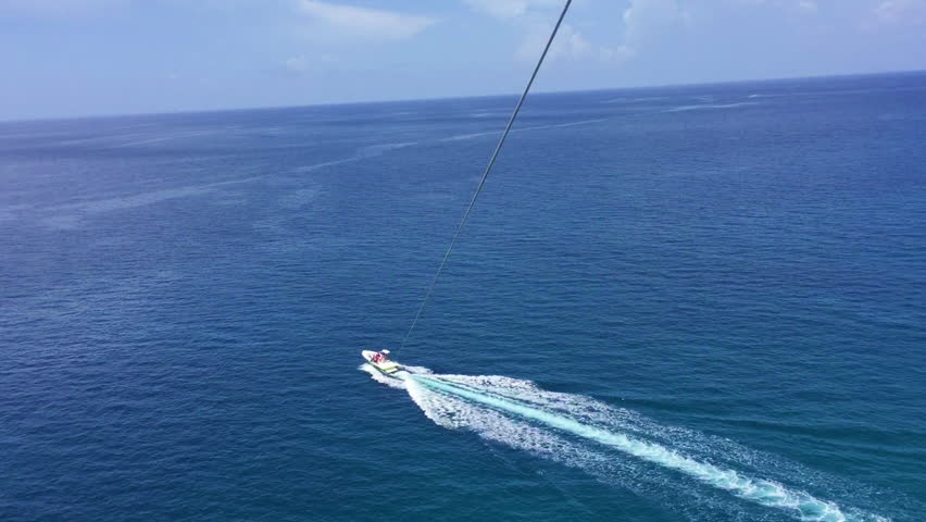 Parasailing above the Atlantic Ocean near the Bahamas | Shutterstock HD Video #1018722073
